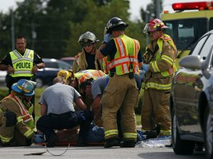 Police, firefighters and EMT workers respond to the scene of a traffic accident, where a motorcycle crashed into a car on College St. as the car attempted to enter traffic from Scenic Ave. in Springfield, Mo. on July 30, 2015. The motorcycle driver was taken to the hospital with non life-threatening injuries.  Guillermo Hernandez Martinez, Guillermo Hernandez Martinez/News-Leader
